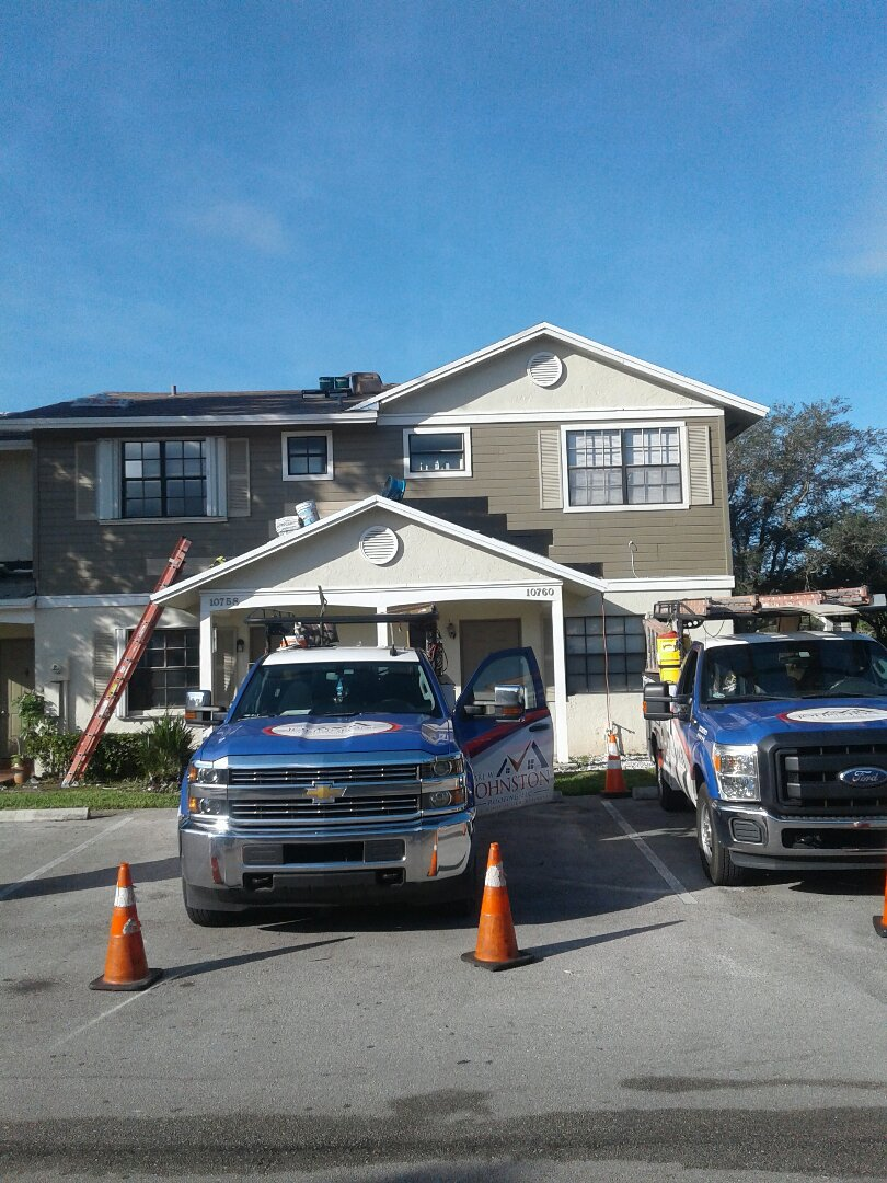 Building 15 re-roofing being done by Earl W Johnston roofing company in the city of Pembroke Pines Florida
