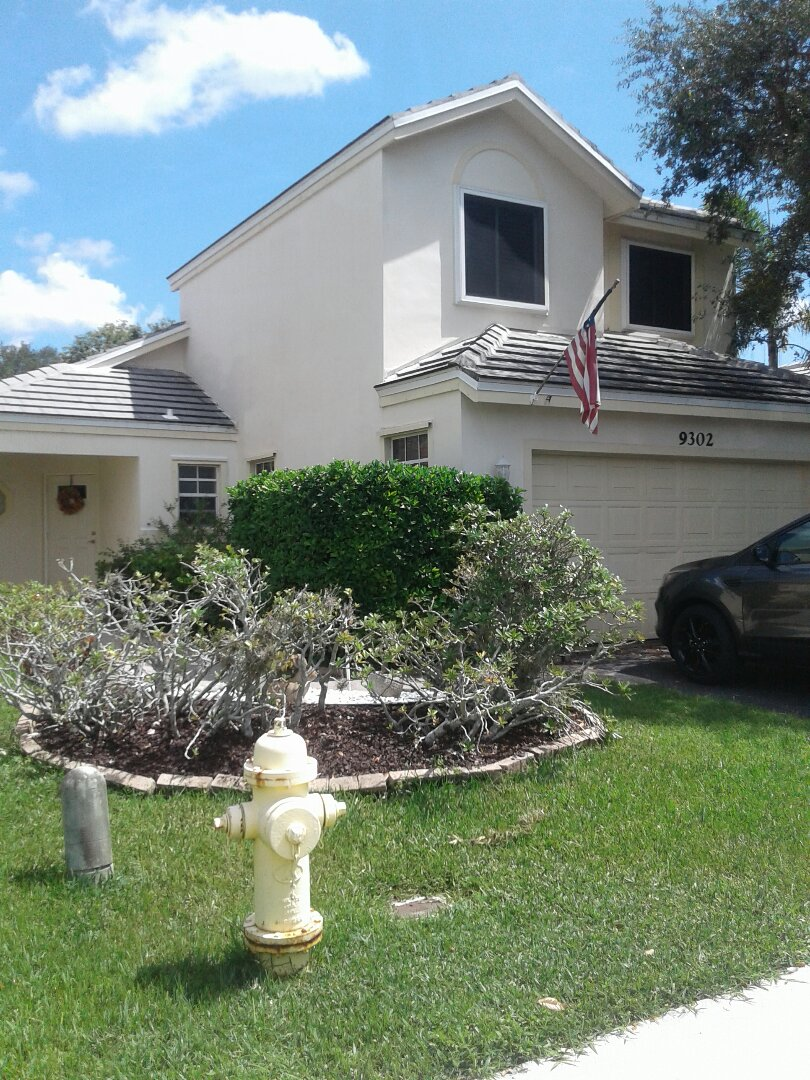Davie, FL - Roof tile repair in the city of Davie Florida this repair is being done by Earl W Johnston roofing company Tony and Regis are your repair technician