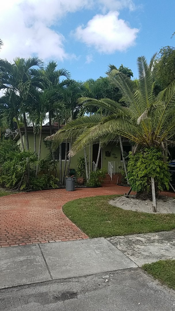Miami Springs, FL - Eagle Bel Air tiles reroof estimate by Earl Johnston Roofing Company