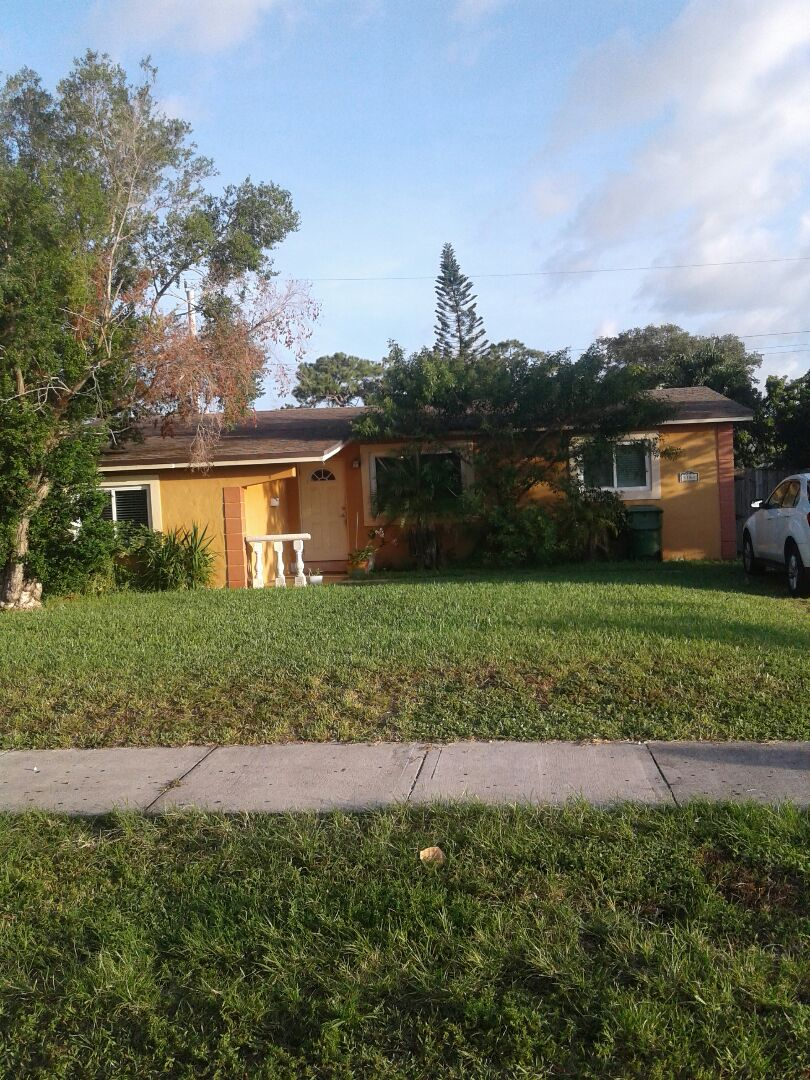 Surfside, FL - Shingle roof repair in the city of Fort Lauderdale Florida this repair is being done by Earl W Johnston roofing company Tony and Regis are your repair technicians