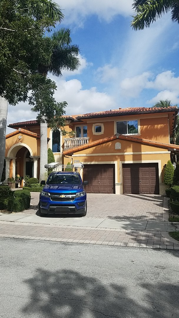 Miami Lakes, FL - Santafe S clay tiles roof replacement estimate by Earl Johnston Roofing Company