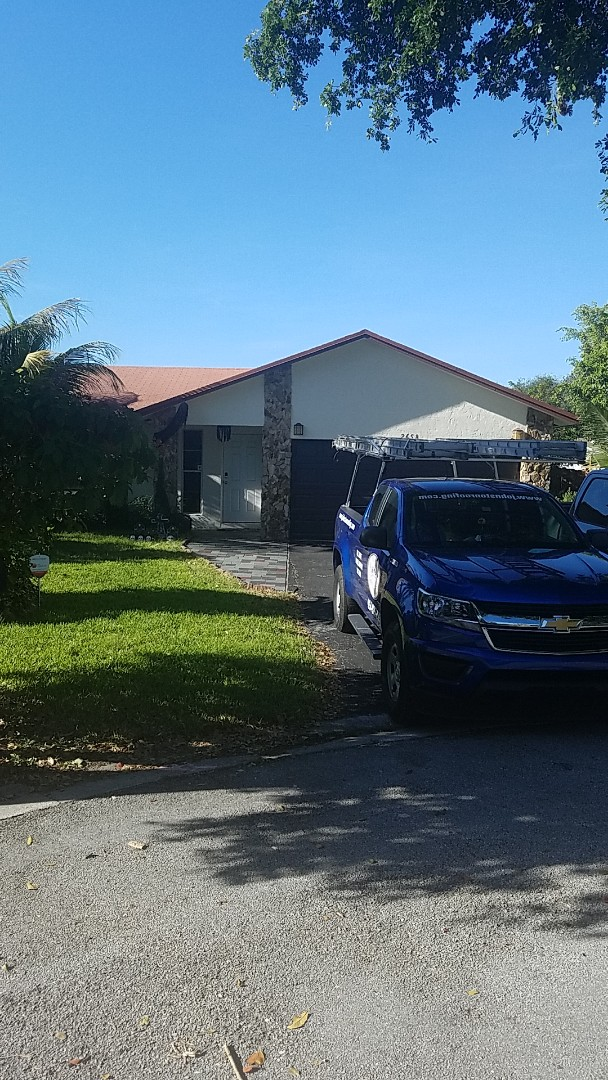 Coral Springs, FL - GAF timberline HD shingles reroof estimate by Earl Johnston Roofing Company