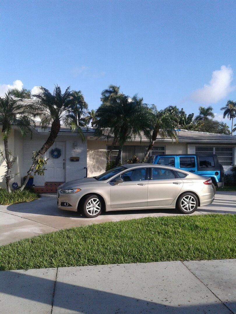 Hollywood, FL - Tile roof repair in the city of Hollywood Florida this repair is being done by Earl W Johnston roofing company Tony Regis and Mariner are you repair technicians