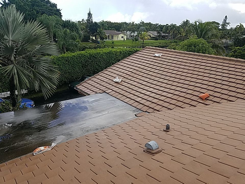 Hollywood, FL - Tile and flat re-roof estimate in Cooper City, FL