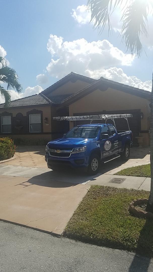Hialeah, FL - Eagle Malibu tile reroof estimate by Earl Johnston Roofing Company