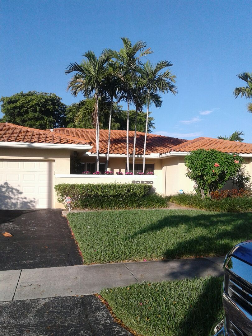 Miami, FL - Roof repair in the city of North Miami Beach Florida this repair is being done by Earl W Johnston roofing company Tony Regis and Israel are you repair technicians