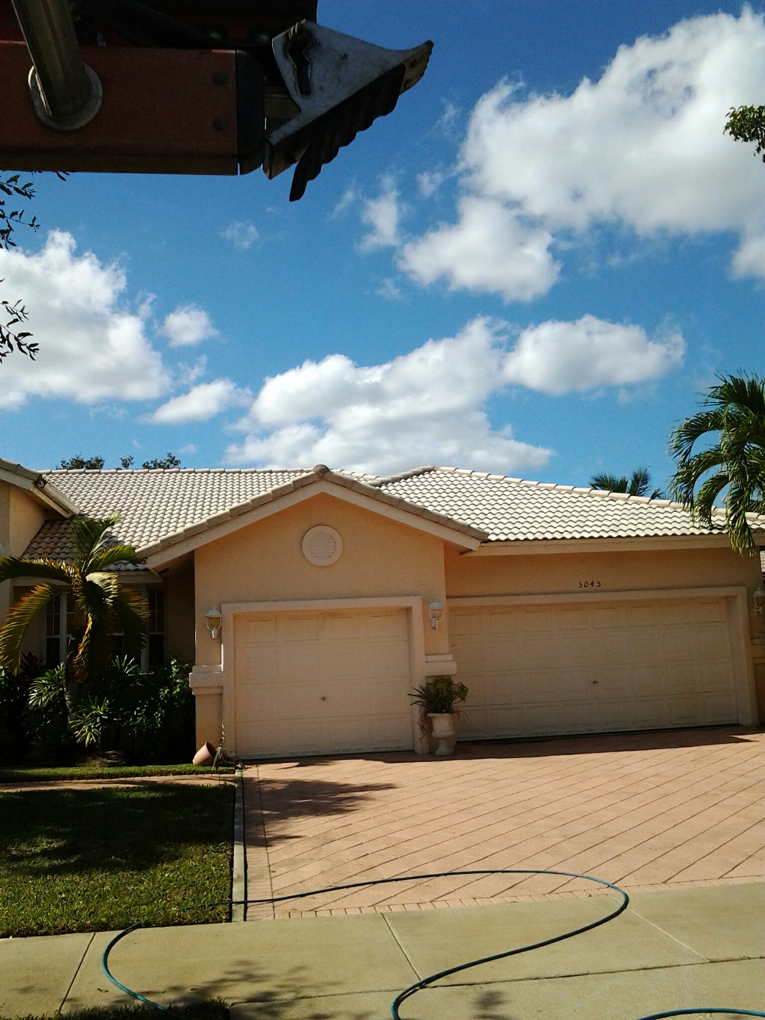 Cooper City, FL - Pressure clean roof  driveway and clean gutters