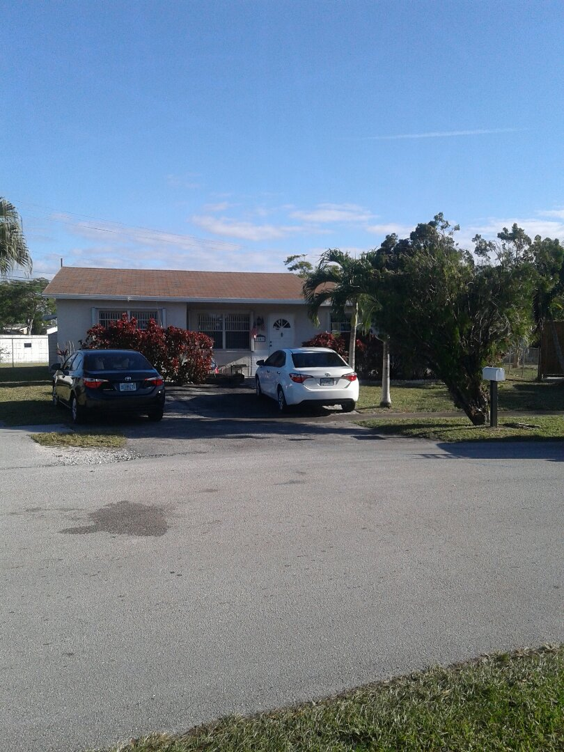Pompano Beach, FL - Roof repair in the city of North Lauderdale Florida this repair is being done by Earl W. Johnston roofing company Tony Regis and Israel are you repair technicians