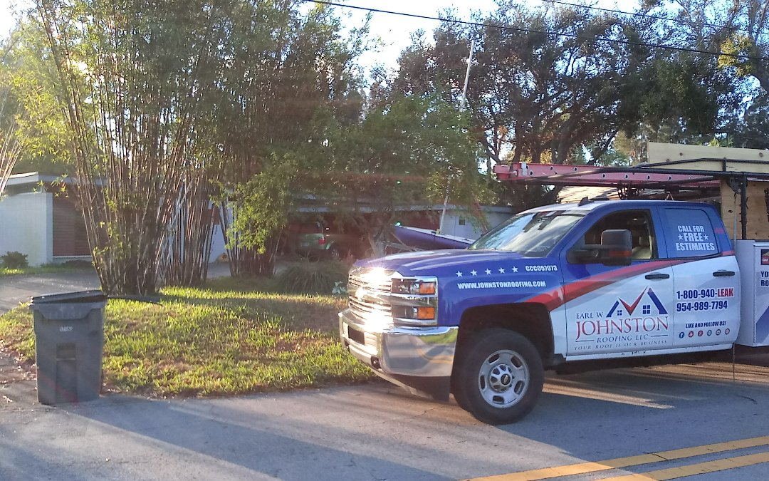 Davie, FL - Flat roof repair in the city of hollywood fl this repair is being done by earl w johnston roofing company jose end duane are you repair technician