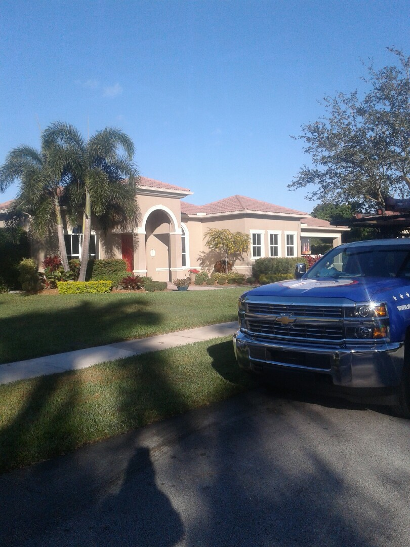 Davie, FL - Tile roof repair in the city of Davie Florida this repair is being done by Earl W. Johnston roofing company Tony Israel Regis and Mariner are you a repair technicians
