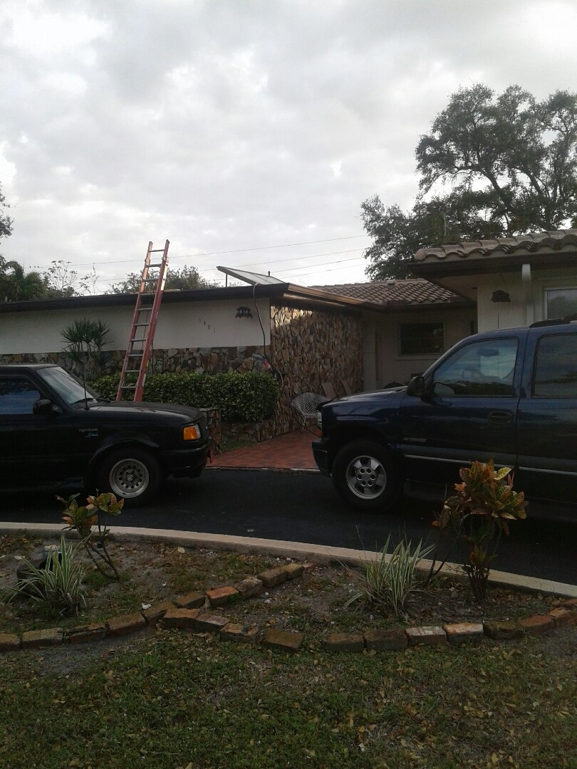 Miami, FL - Flat deck roof repair in the city of Pembroke Pines Florida this repair is being done by Earl W. Johnston roofing company Tony and Regis are your repair technicians