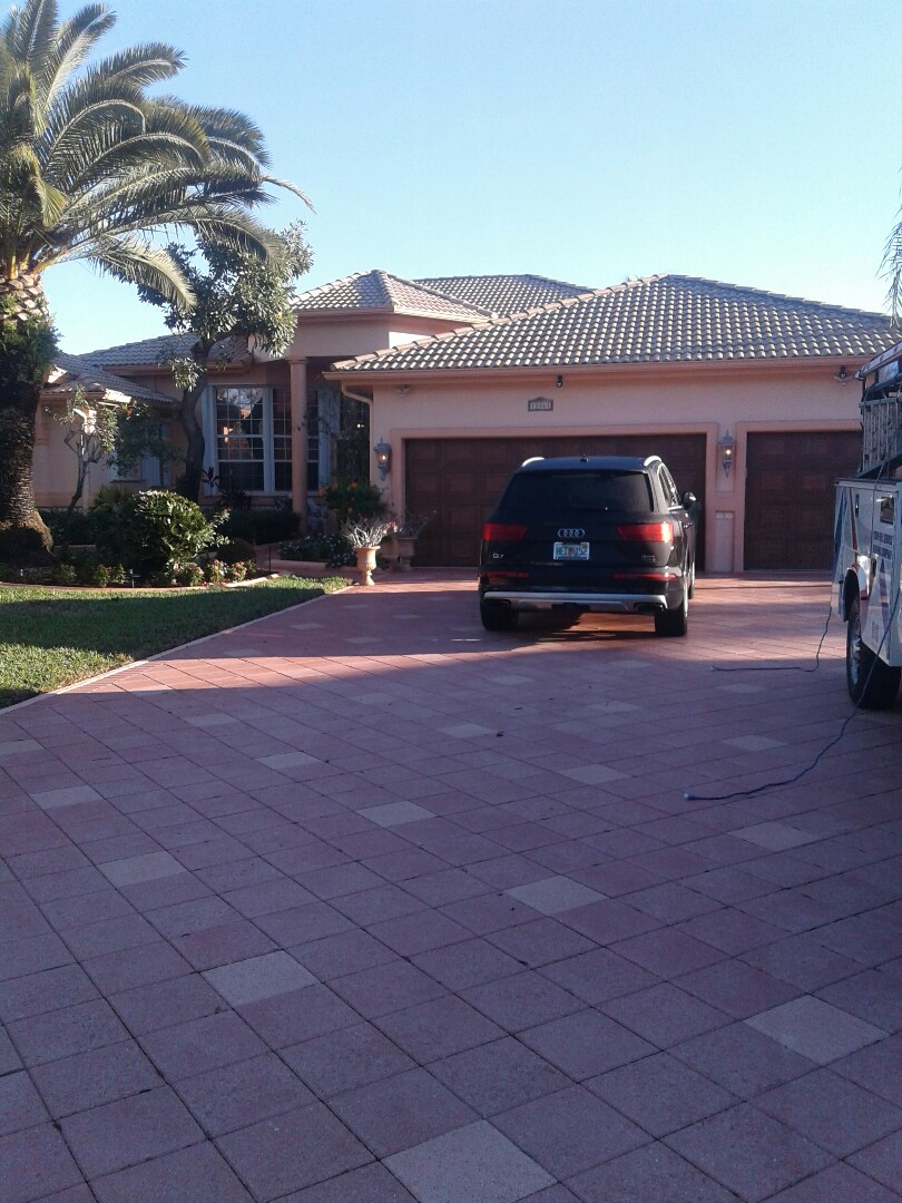 Cooper City, FL - Tile roof repair in the city of Cooper City Florida this repair is being done by Earl W Johnston roofing company Tony and Regis are your repair technicians