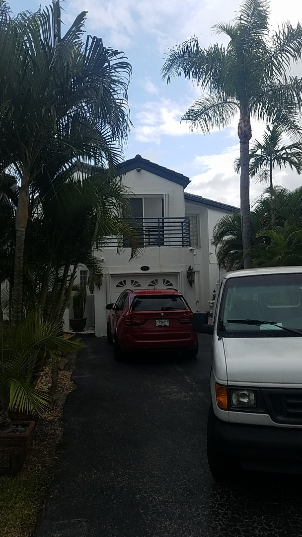 Miami, FL - Tile roof leak repair estimate by Earl Johnston Roofing Company