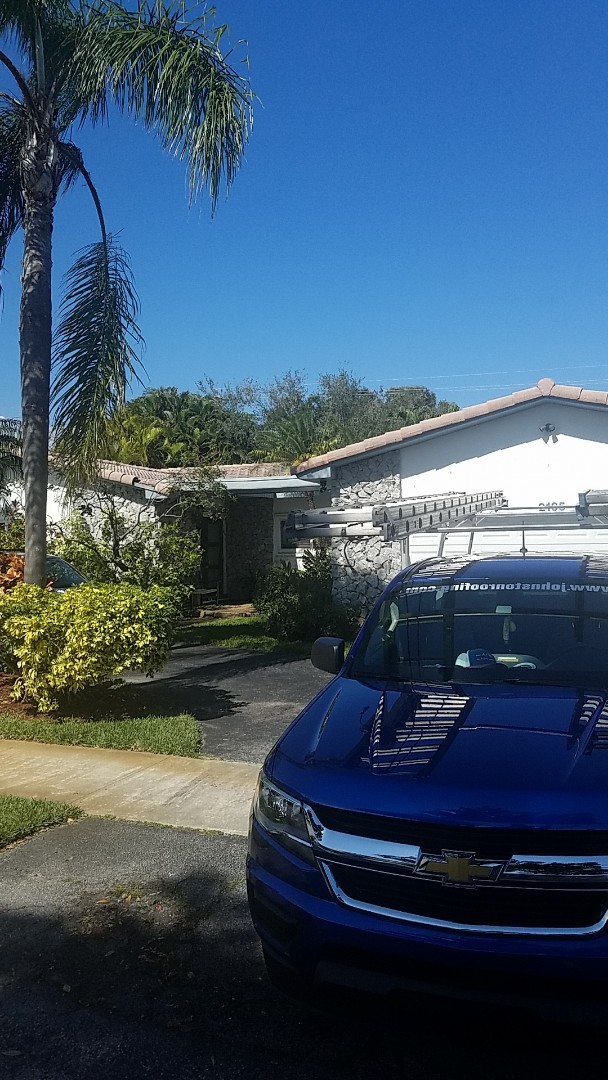 Miami, FL - Flat roof leak repair estimate by Earl Johnston Roofing Company