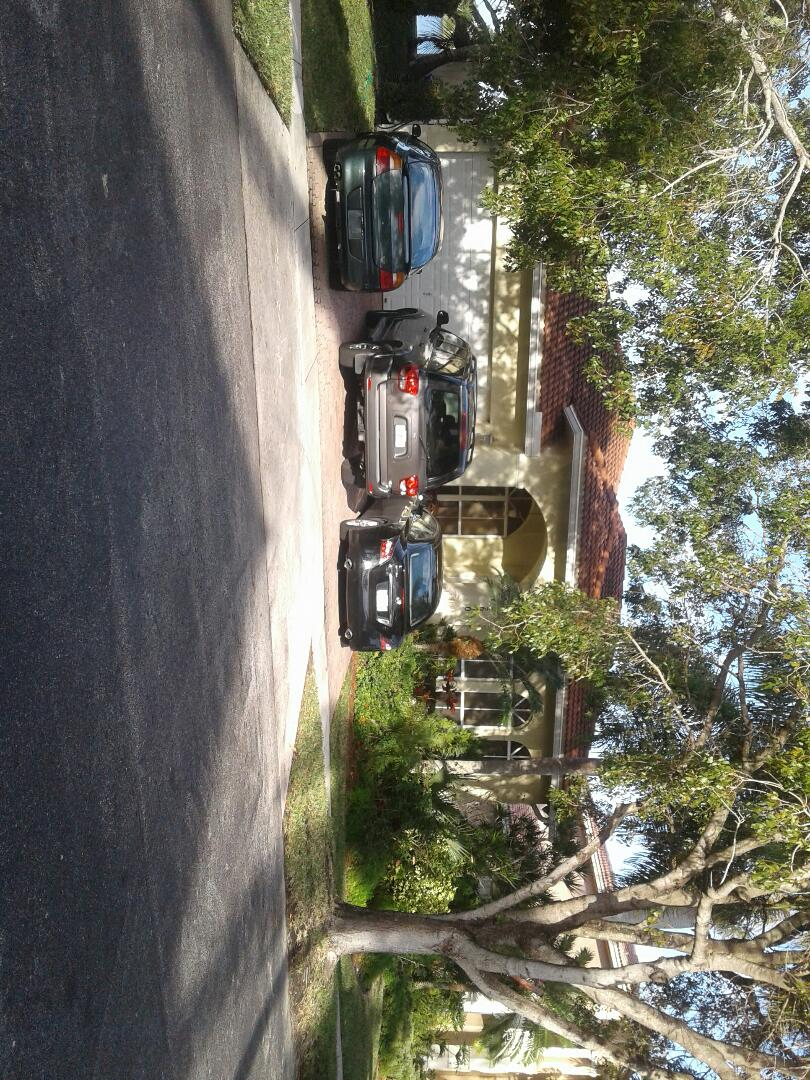 Miramar, FL - Roof tile repair in the city of Miramar Florida this repairs being done by Earl W Johnston roofing company Tony and Regis are your repair technicians