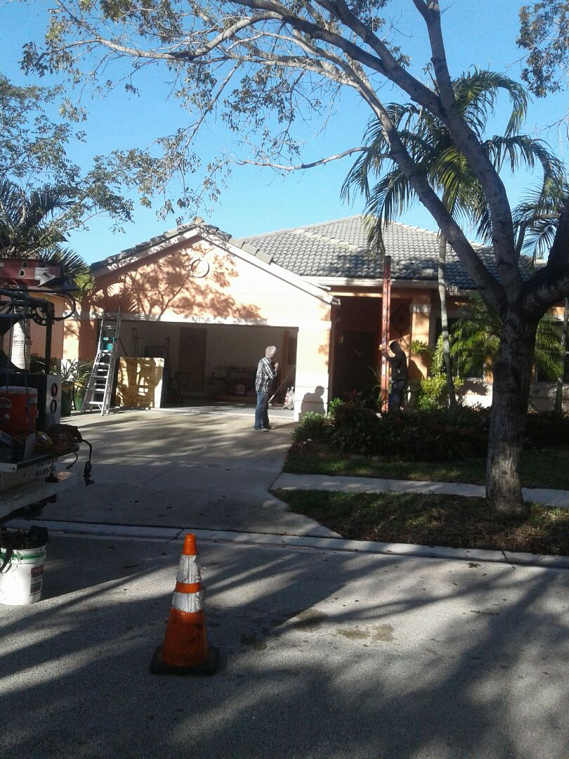 Weston, FL - Tile roof repair in the city of Weston Florida this repairs being done by Earl W Johnson roofing company Tony and Regis are you repair technicians