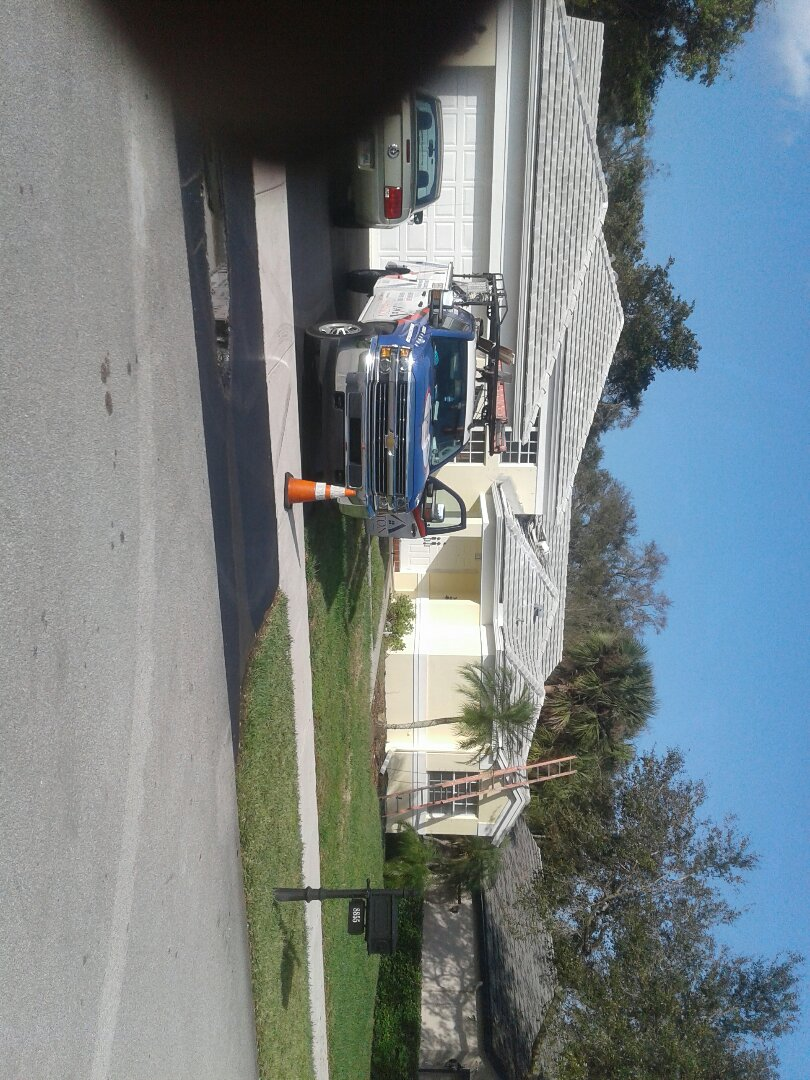 Davie, FL - Roof tile repair in the city of Davie Florida this repair is being done by Earl W Johnston roofing company Tony and Mariner are your repair technicians