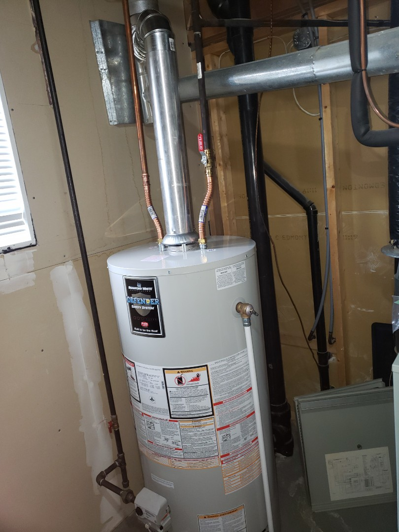 Lloydminster, AB - Just installed this beautiful hot water tank. Also cleaned up this customers furnace and fireplace .