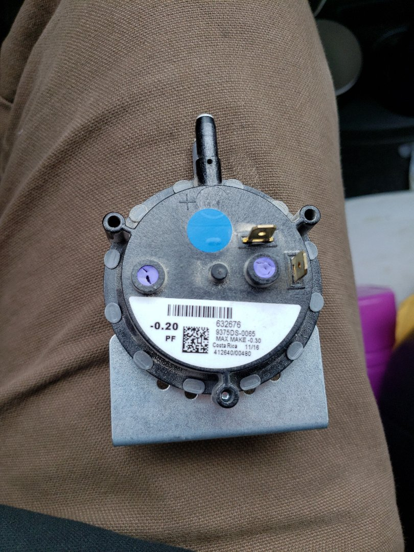 Just got the heat back on by replacing this pressure switch.