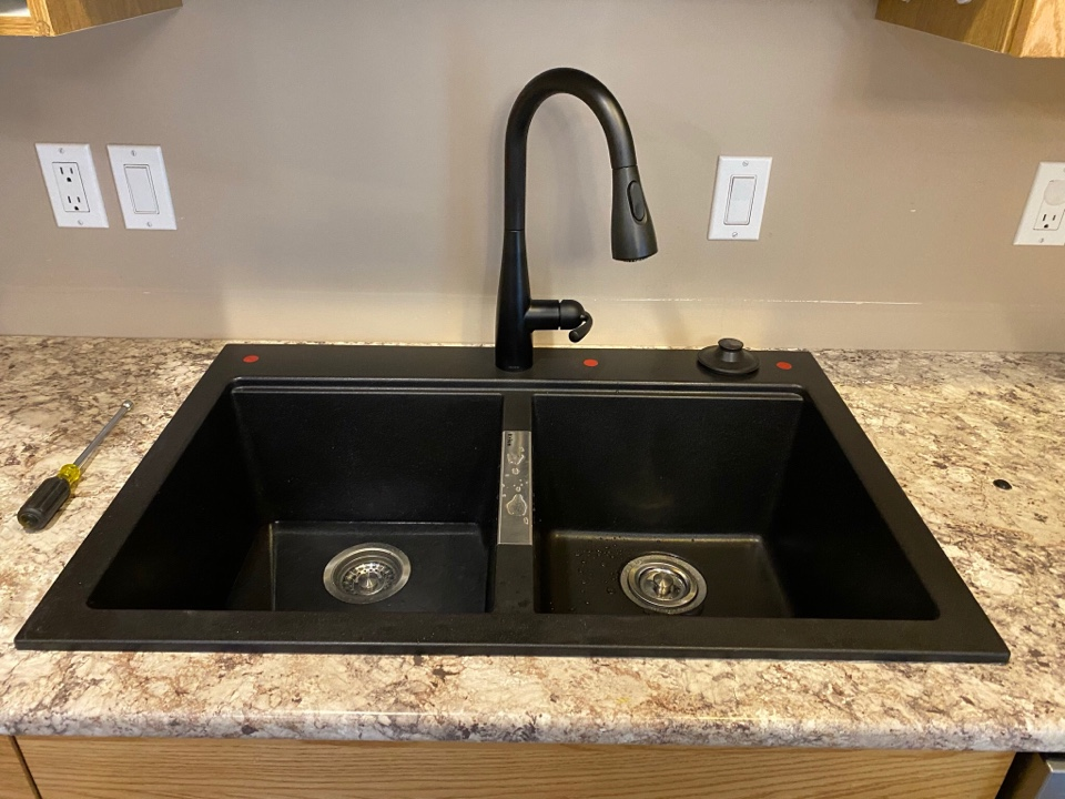 Lloydminster, SK - A new sink and set of taps for this great family.