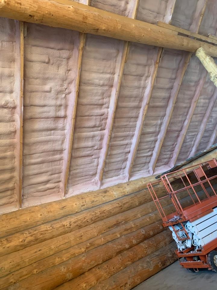 Spray foam log cabin ceiling 3.5 inches. Keep the warm in