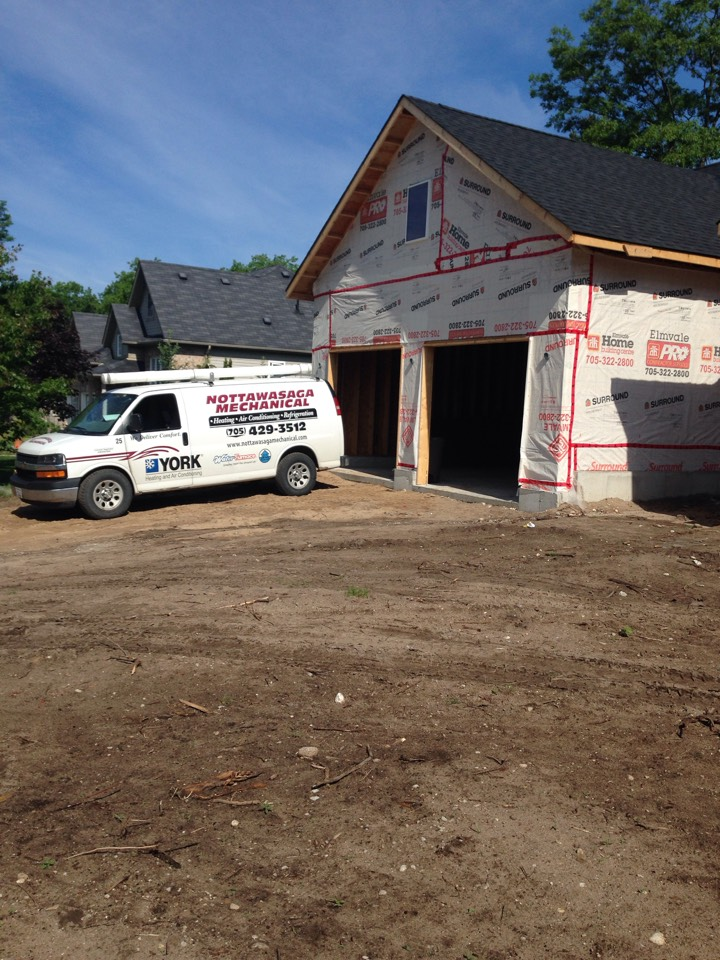 Honeywood, ON - Navien tankless on demand hot water for new construction house.