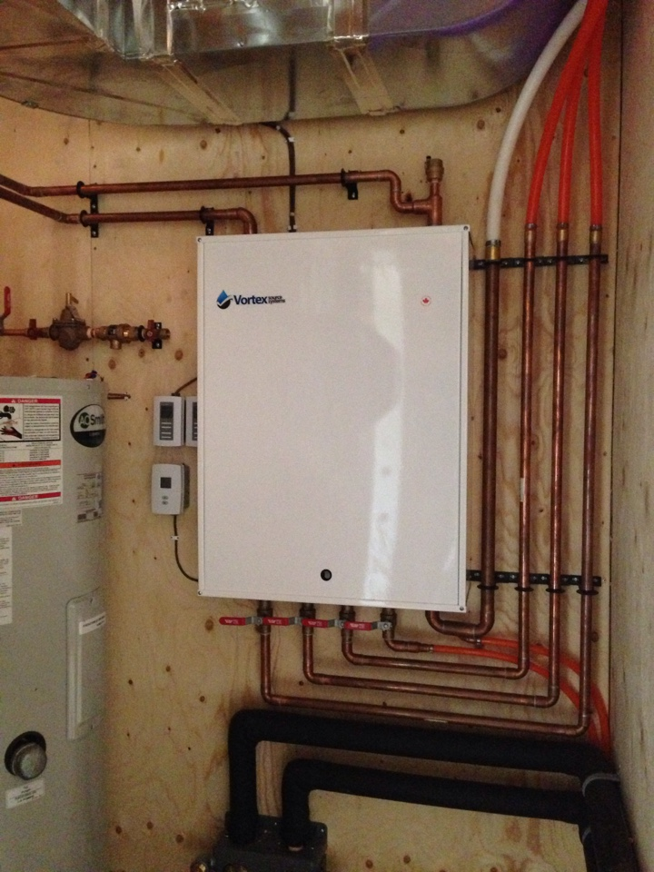 Honeywood, ON - Geothermal Heat Pump providing hot water for Infloor heat! Controlled by in slab sensors. Installed by AJ