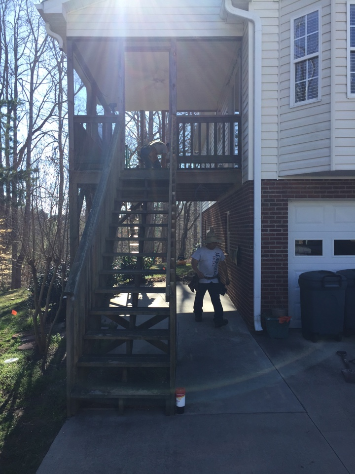 Removing old deck stairs, removing old screen and wood trim. Installing new stair case with landing in opposite direction installed a screen tite system with caps to match home