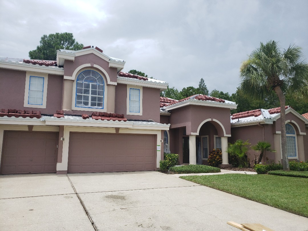Tampa, FL - Tile just got loaded on an Eagle Tile Roof in Westchase.