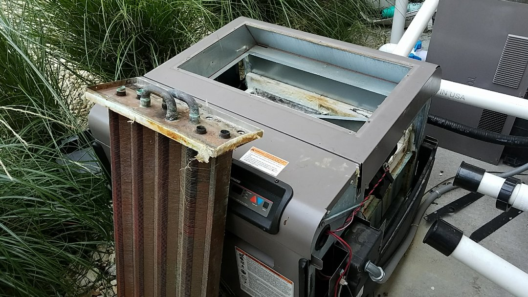 Joplin, MO - Heater repair.  Haywood pool heater breast exchanger replacement.