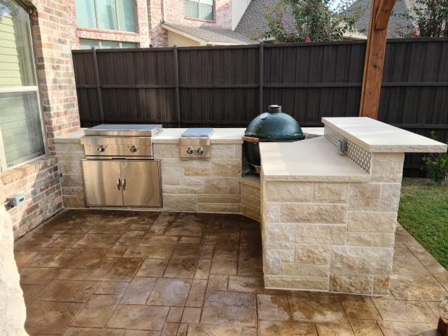 Allen, TX - Outdoor Kitchen with built in Stove Top, Bar and Green Egg spot. Stamp and stained concrete patio.