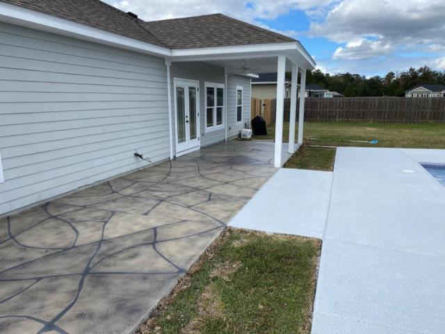 Monticello, FL - Absolutely stunning results from Floor Warriors! Steve and his crew a fantastic job on our patio and pool deck last year. The concrete surfaces have both been through a whole year of Florida weather, and still, they look as if they were remodeled yesterday! The patio was created with a Grand Flagstone design, and the pool deck with a Graniflex coat. We have been receiving raving comments from friends and family! If anyone is looking to have their concrete remodeled, I recommend calling Floor Warriors first!!