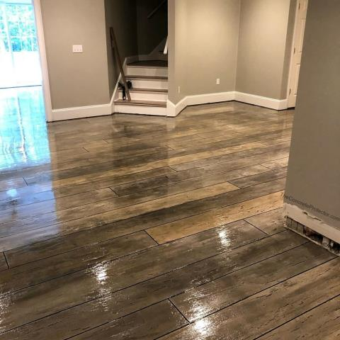Moultrie, GA - This epoxy wood decorative concrete floor is GORGEOUS! Honestly, the perfect floor for this room! I love the realistic look and its fantastic for kids because its going to stay shiny and quality-looking for a long time! Floor Warriors knows how to make great decorative flooring!