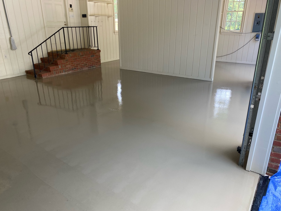 Thomasville, GA - The team just put down the base coat of graniflex today on this 3-car concrete garage floor. Near Thomasville Georgia.