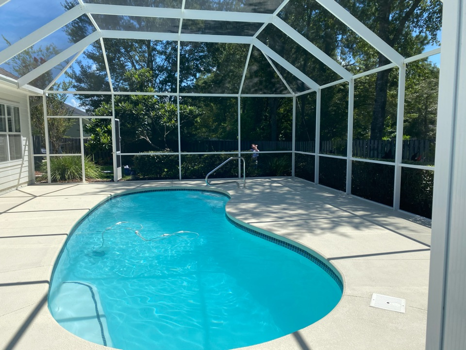 """Thomasville, GA - We just finished this Kooldeck resealing project and it turned out fantastic. We fixed all the cracks and resealed tho concrete pool deck with our """"Natural"""" color concrete sealer. Near Thomasville Georgia."""