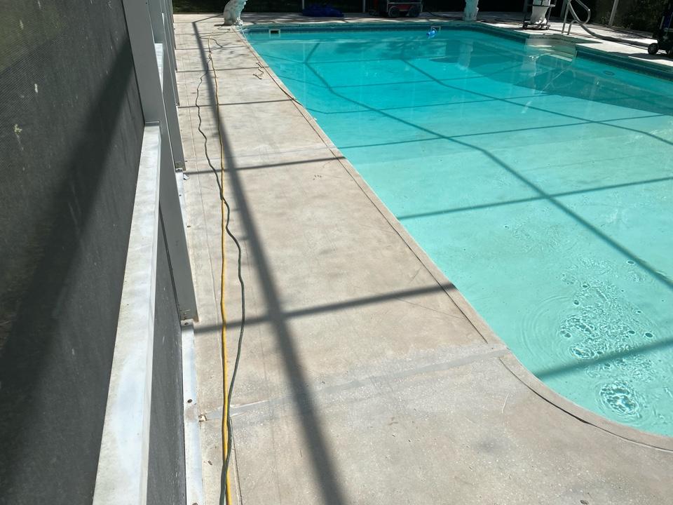 Tallahassee, FL - So we've finished grinding all of the control joints on this concrete pool deck project. Next we acid wash, neutralize and power wash the surface clean.