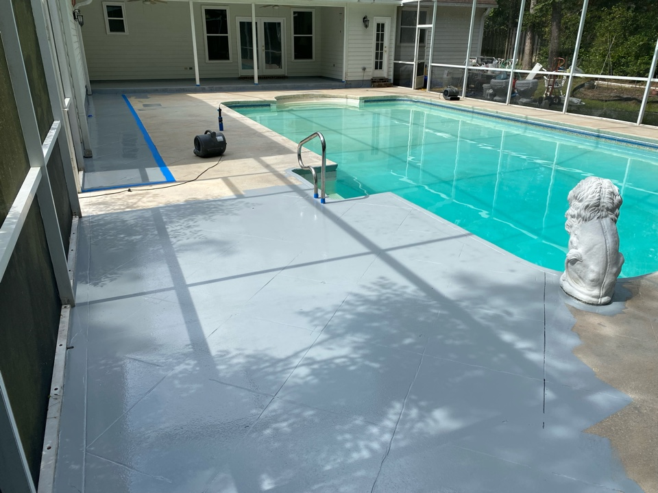 Tallahassee, FL - The basecoat of our Graniflex system is going down today were using gray colored basecoat and tomorrow we will be flaking it stay tuned for further.