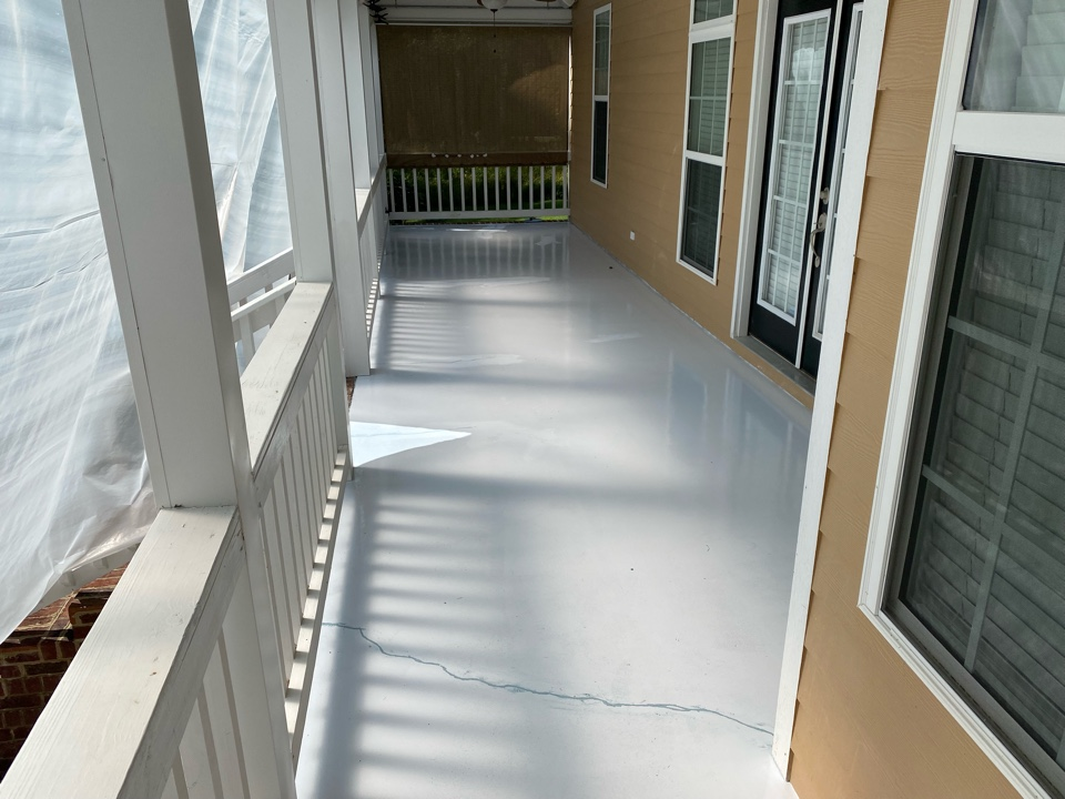 Thomasville, GA - Today we're working on some cracks in this concrete porch project. We're filling in these cracks with our rubber crack filler.