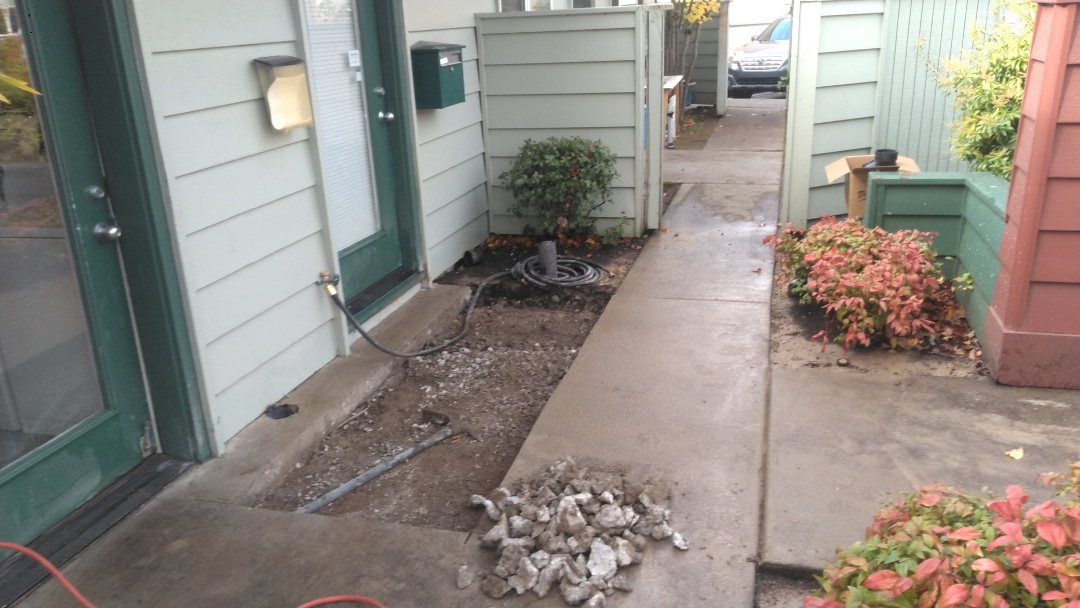 Clackamas, OR - Beaverton Oregon Sanitary sewer line spot right. Concrete saw cutting and removal.