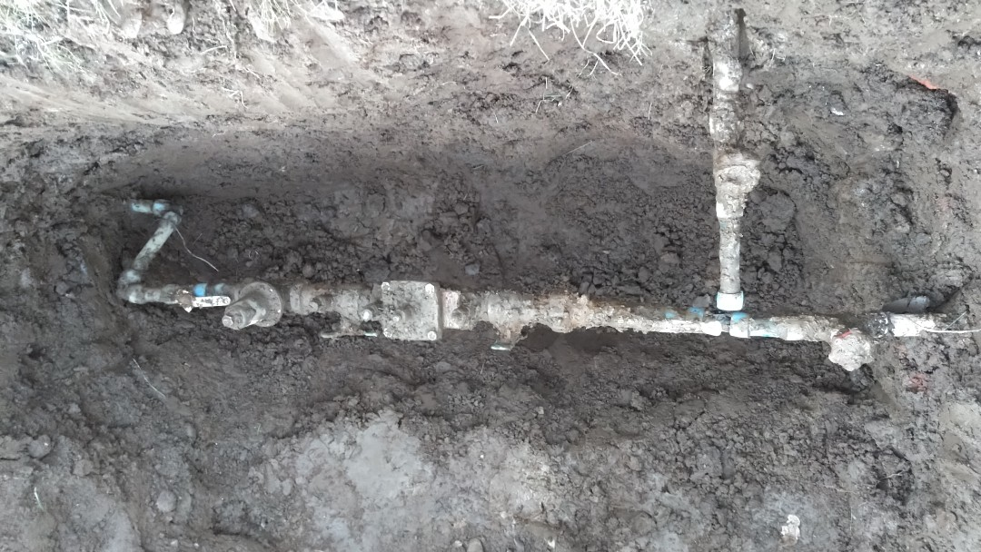 Troutdale, OR - Digging up old pressure reducing valve for replacement. Troutdale. Springdale.
