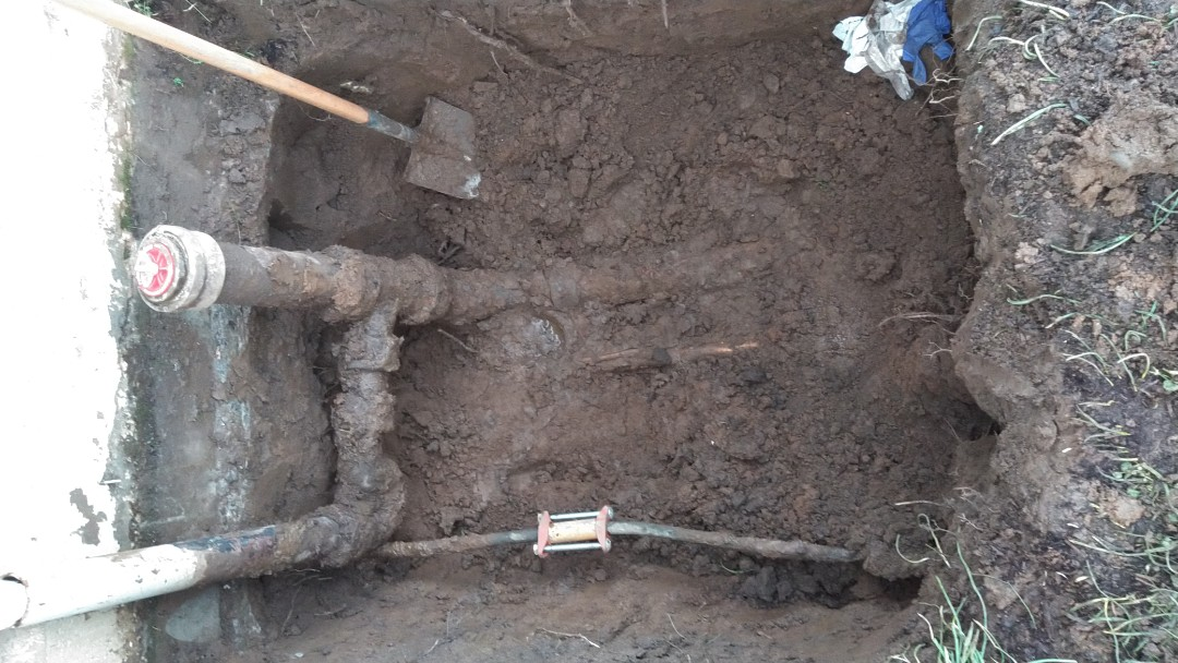 Portland, OR - Running new sewer line from face of the curb to crawl space as well as boring new water service from water meter box to crawl space. Northeast Portland.