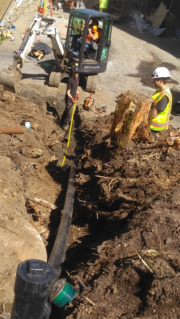 Gresham, OR - Trenching 40 ft on slope replacing 4-in cast iron with 4-in ABS pipe from edge of parkway to manhole. Gresham