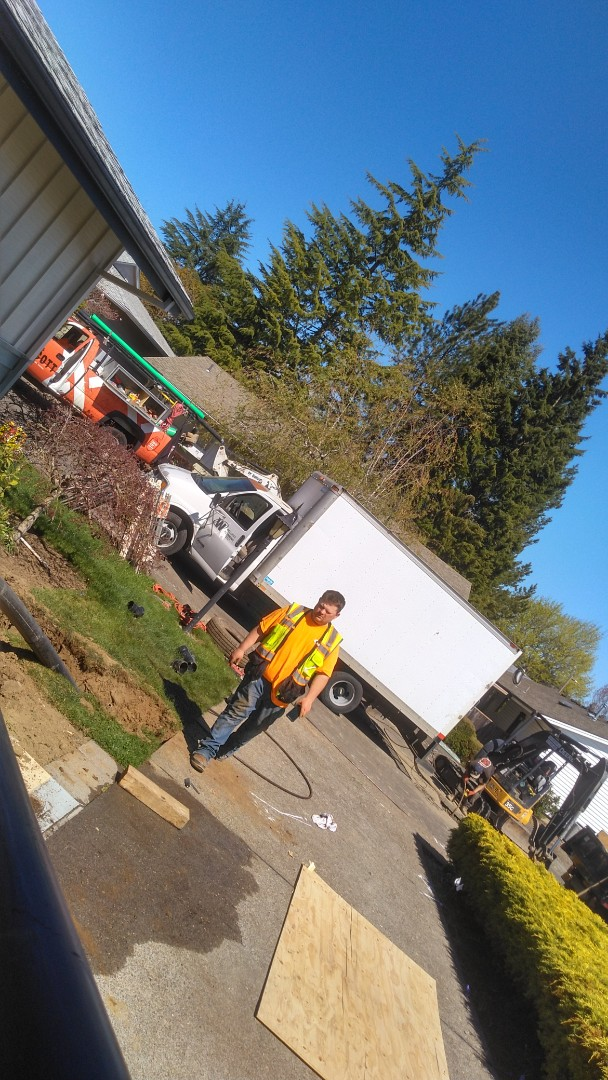 King City, OR - Bursting new 4-in HDPE pipe from clean out to City Main line replacing old cast iron sewer pipe. King City.