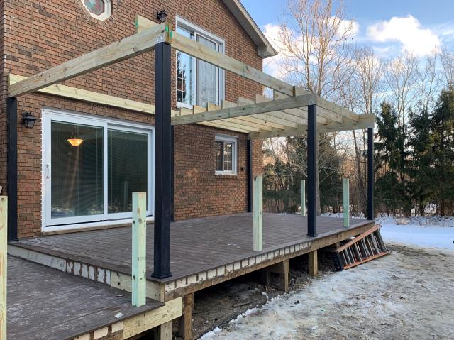 Wixom, MI - It's February and still building a multi-level Trex Transcend Deck,  this homeowner is preparing for spring!