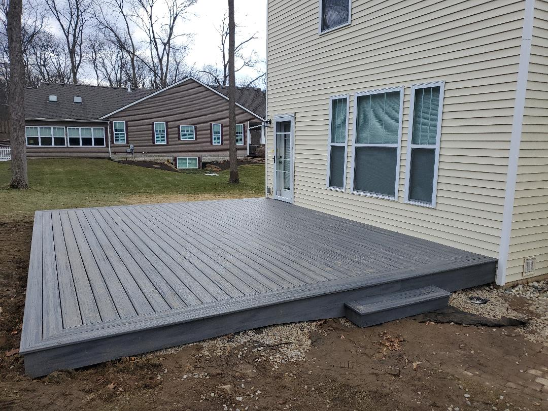Brighton, MI - DHC working hard cleaning up after a deck project! We work in all weather conditions!