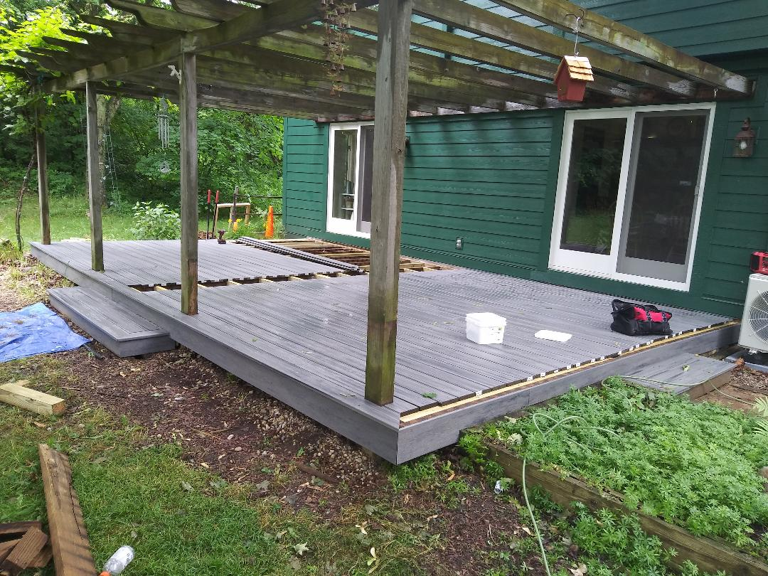 Superior Charter Township, MI - Finishing touches on a island mist trex deck.