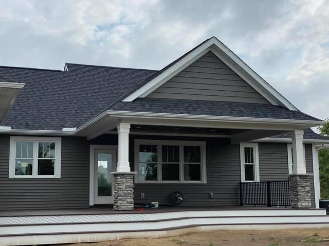 Howell, MI - Happy to say this customer was able to move into her new Home Built by Down Home Construction. Not only did we build her a beautiful new home, but she also has a beautiful Trex deck with a covered porch. Now she has a place to watch the deer play all year long!
