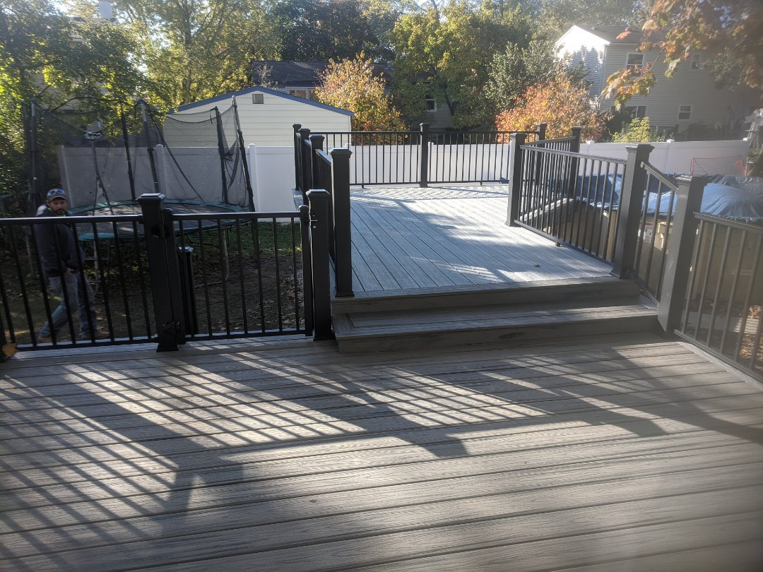 Plymouth, MI - In four days from a old wood deck with limited access to pool to a beautiful trex deck with easy access to the pool
