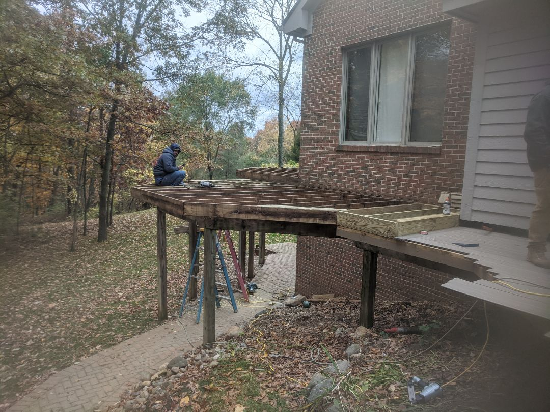 Milford Charter Township, MI - Day two of a retop from old wood to trex rail and decking