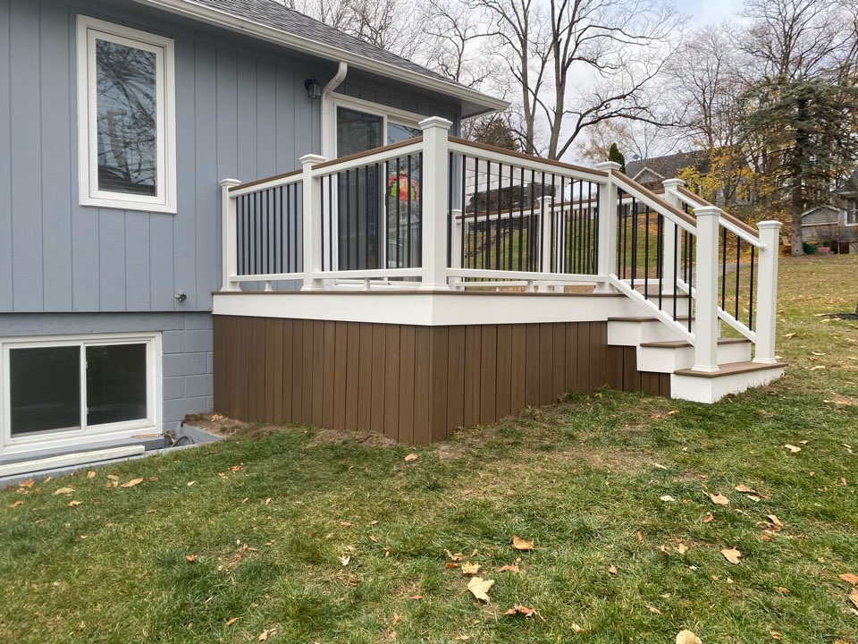 Brighton, MI - Had the privilege of helping another homeowner enhance their back and front yard right outside of downtown Brighton. We built a brand new Toasted Sand Trex deck featuring a cocktail rail and skirting in the front. In the back we replaced their private balcony deck with Toasted Sand Trex decking and a cocktail rail. Both decks received a Azek fascia to complete the look!